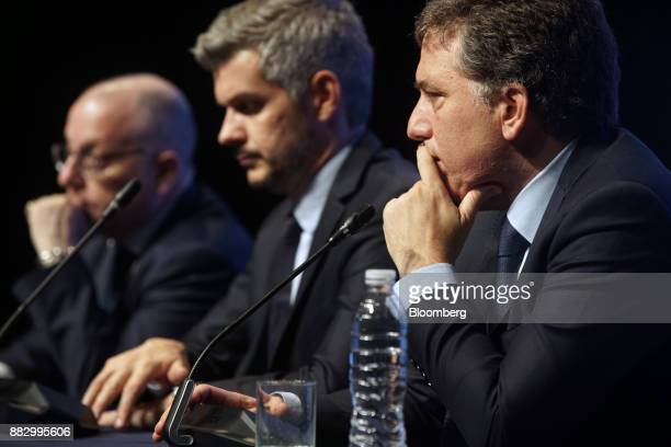 Nicolas Dujovne Argentina's treasury minister right listens to a question from a member of the media during a press conference following the...