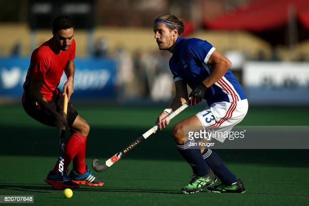 Nicolas Dumont of France battles with Ahmed Gamal of Egypt during day 8 of the FIH Hockey World League Men's Semi Finals 5th/ 6th place match between...