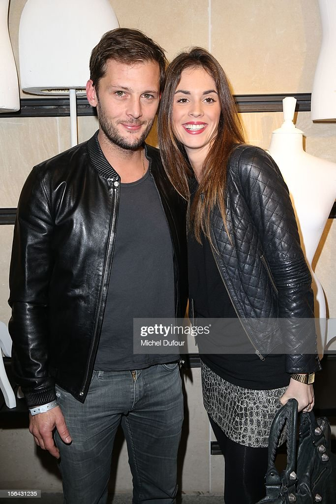 Nicolas Duvauchelle and his wife attend the Maison Martin Margiela With H&M Collection Launch at H&M Champs Elysees on November 14, 2012 in Paris, France.