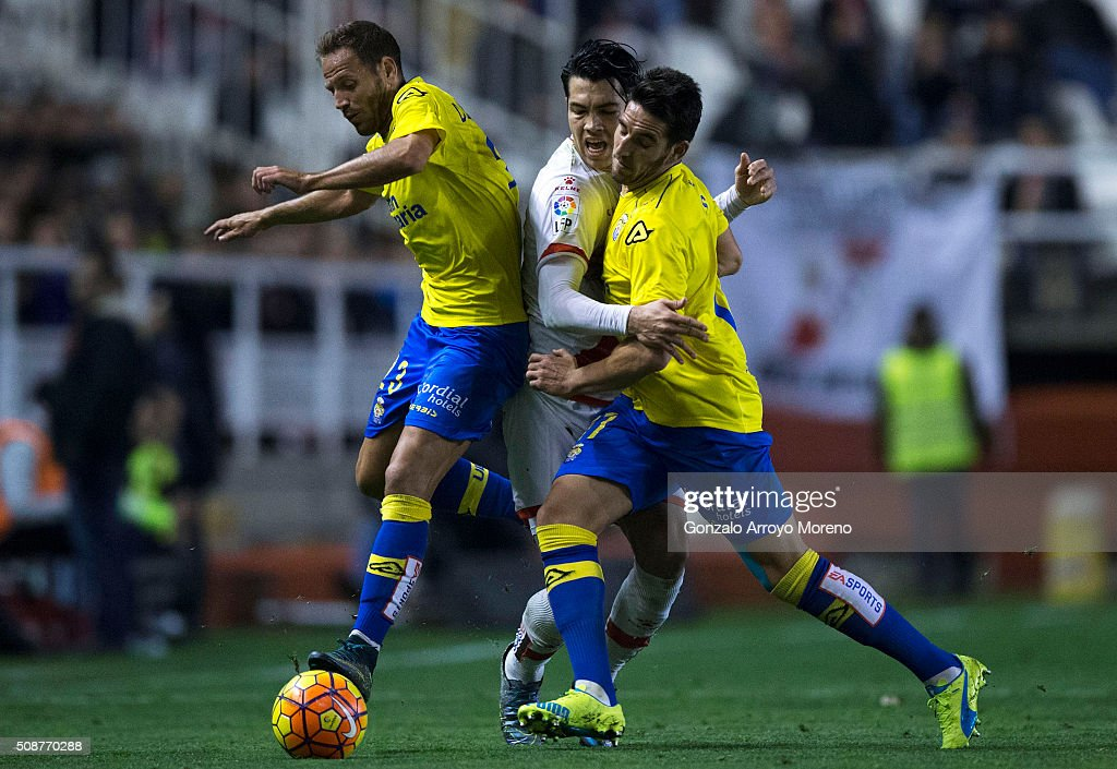 Nicolas Fedor Flores alias Miku (2ndL) of Rayo Vallecano de Madrid competes for the ball with Daniel Castello (L) of UD Las Palmas and his teammate Pedro Bigas (R) during the La Liga match between Rayo Vallecano de Madrid and UD Las Palmas at Estadio de Vallecas on February 6, 2016 in Madrid, Spain.