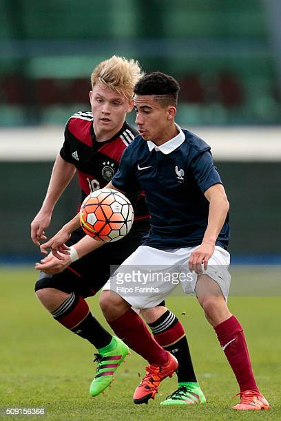 Nicolas Fontaine of France challenges Dominik Marx of Germany during the UEFA Under16 match between U16 France v U16 Germany on February 6 2016 in...