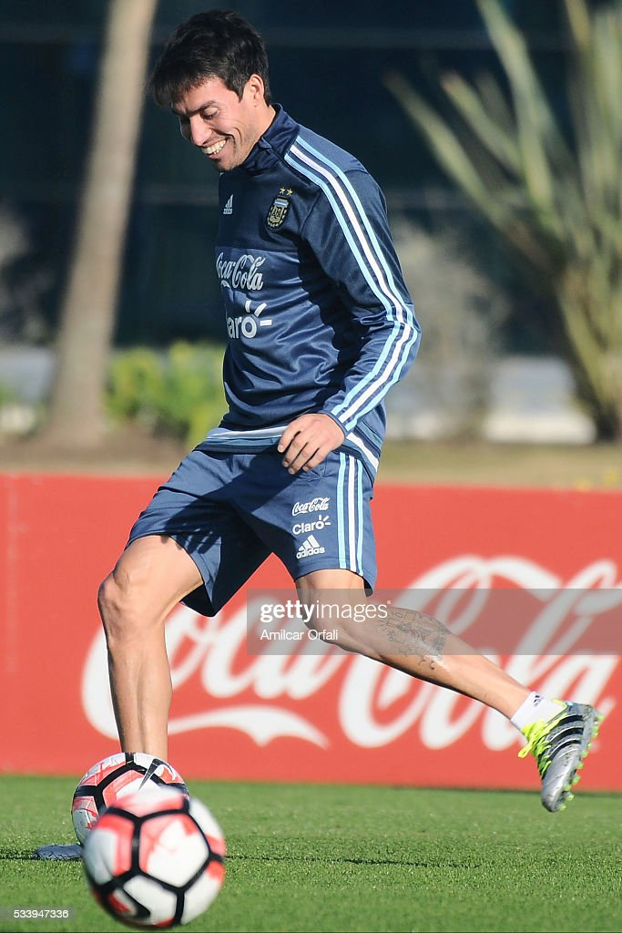 <a gi-track='captionPersonalityLinkClicked' href=/galleries/search?phrase=Nicolas+Gaitan&family=editorial&specificpeople=5538639 ng-click='$event.stopPropagation()'>Nicolas Gaitan</a> drives the ball during a training session at Argentine Football Association (AFA) 'Julio Humberto Grondona' training camp on May 24, 2015 in Ezeiza, Argentina. Argentina will face Honduras on May 27, 2015.