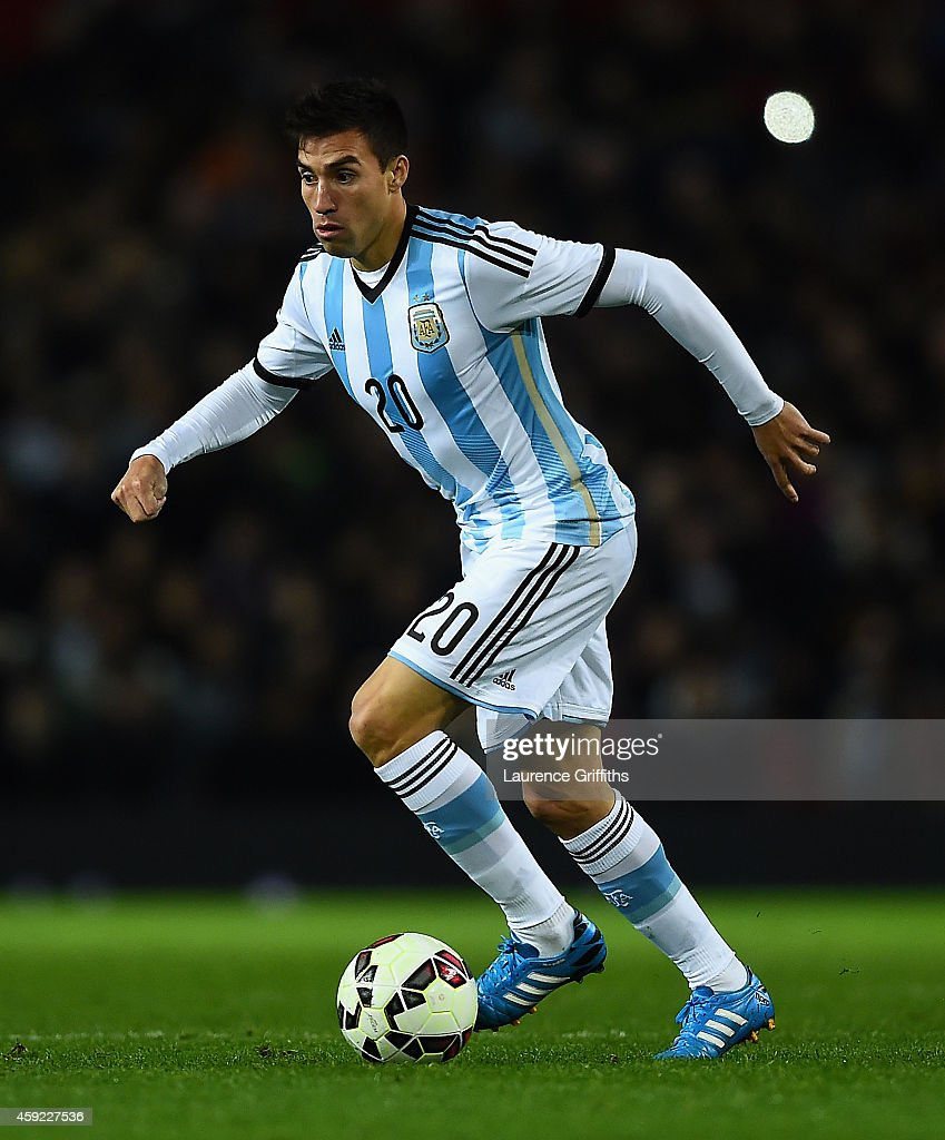 <a gi-track='captionPersonalityLinkClicked' href=/galleries/search?phrase=Nicolas+Gaitan&family=editorial&specificpeople=5538639 ng-click='$event.stopPropagation()'>Nicolas Gaitan</a> of Argentina in action during the International Friendly match between Argentina and Portugal at Old Trafford on November 18, 2014 in Manchester, England.
