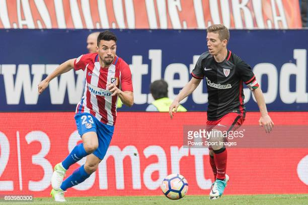 Nicolas Gaitan of Atletico de Madrid fights for the ball with Iker Muniain Goni of Athletic Club during the La Liga match between Atletico de Madrid...