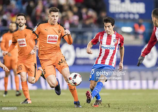 Nicolas Gaitan of Atletico de Madrid fights for the ball with Cristian Rivera Hernandez of SD Eibar during their Copa del Rey 201617 Quarterfinal...