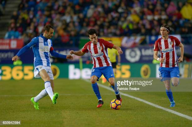 Nicolas Gaitan of Atletico de Madrid fights the ball with Victor Dias of Leganes during La Liga match between Atletico Madrid and Leganes at Vicente...