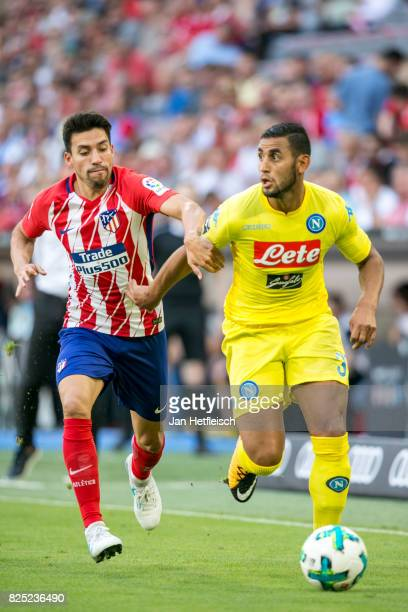 Nicolas Gaitan of Atletico Madrid and Faouzi Ghoulam of SSC Napoli fight for the ball during the Audi Cup 2017 match between Club Atletico de Madrid...