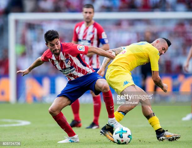 Nicolas Gaitan of Atletico Madrid battles for the ball with Marek Hamsik of SSC Napoli during the Audi Cup 2017 match between Club Atletico de Madrid...