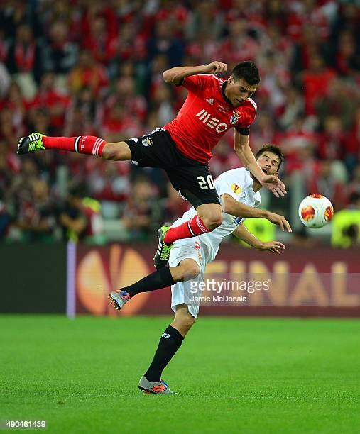 Nicolas Gaitan of Benfica clashes with Coke of Sevilla during the UEFA Europa League Final match between Sevilla FC and SL Benfica at Juventus...