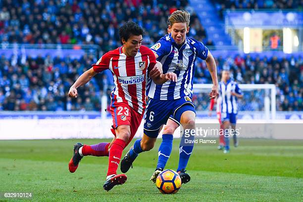 Nicolas Gaitan of Club Atletico de Madrid competes for the ball with Marcos Llorente of Deportivo Alaves during the La Liga match between Deportivo...