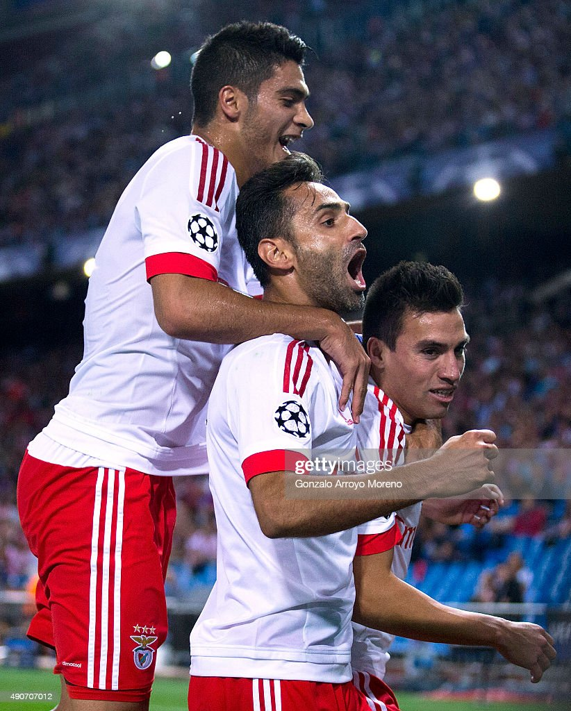 <a gi-track='captionPersonalityLinkClicked' href=/galleries/search?phrase=Nicolas+Gaitan&family=editorial&specificpeople=5538639 ng-click='$event.stopPropagation()'>Nicolas Gaitan</a> (R) of SL Benfica celebrates scoring their opening goal with teammates <a gi-track='captionPersonalityLinkClicked' href=/galleries/search?phrase=Jonas+-+Brazilian+Forward&family=editorial&specificpeople=10555097 ng-click='$event.stopPropagation()'>Jonas</a> Goncalves (2ndL) and Goncalo Guedes (L) during the UEFA Champions League Group C match between Club Atletico de Madrid and SL Benfica at Vicente Calderon Stadium on September 30, 2015 in Madrid, Spain.