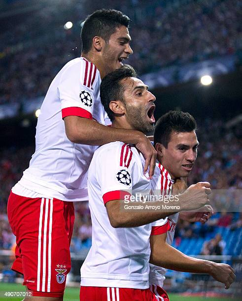 Nicolas Gaitan of SL Benfica celebrates scoring their opening goal with teammates Jonas Goncalves and Goncalo Guedes during the UEFA Champions League...