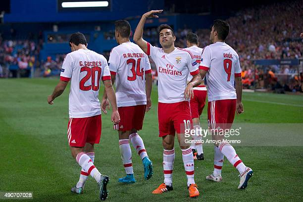 Nicolas Gaitan of SL Benfica celebrates scoring their opening goal with teammates during the UEFA Champions League Group C match between Club...