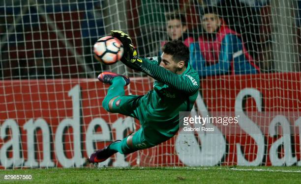Nicolas Gaston Navarro of San Lorenzo saves the last penalty kick during the penalty shootout after a second leg match between San Lorenzo and Emelec...