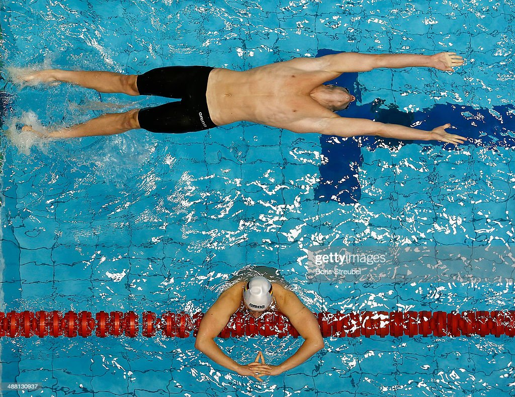 Nicolas Graesser of Deutscher Schwimm-Verband takes the start of the men's 100 m backstroke heat during day three of the German Swimming Championship 2014 at Eurosportpark on May 4, 2014 in Berlin, Germany.
