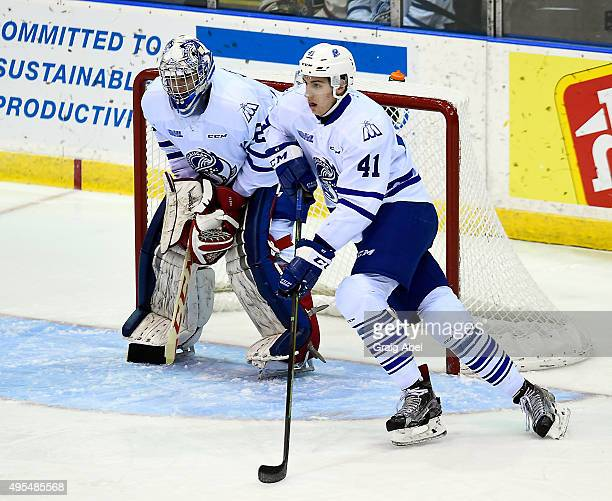 Nicolas Hague controls the puck in front of goalie Jack Finn of the Mississauga Steelheads against the Barrie Colts during OHL game action on...