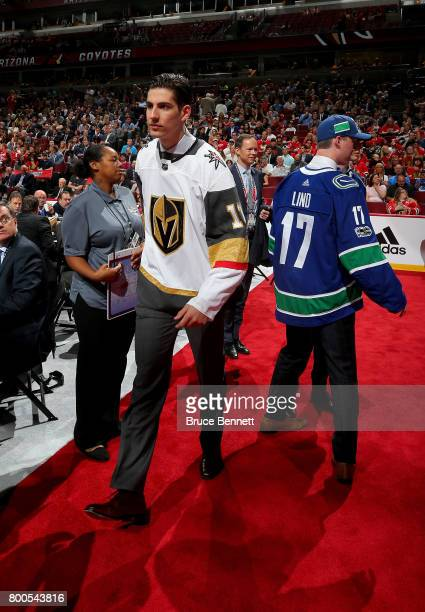 Nicolas Hague left and Kole Lind walk across the floor after being drafted in the second round during the 2017 NHL Draft at the United Center on June...