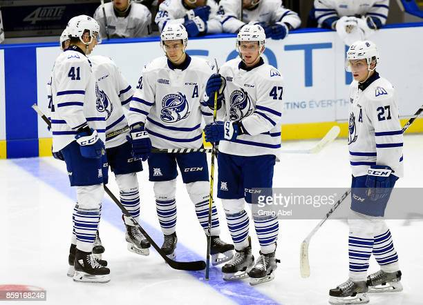 Nicolas Hague Ryan McLeod Trent Fox and Jacob Moverare of the Mississauga Steelheads get together at a time out against the Sudbury Wolves during CHL...