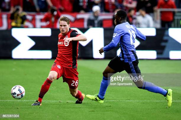 Nicolas Hasler of Toronto FC and Ballou JeanYves Tabla of Montreal Impact battle for the ball during the first half of the MLS Soccer regular season...