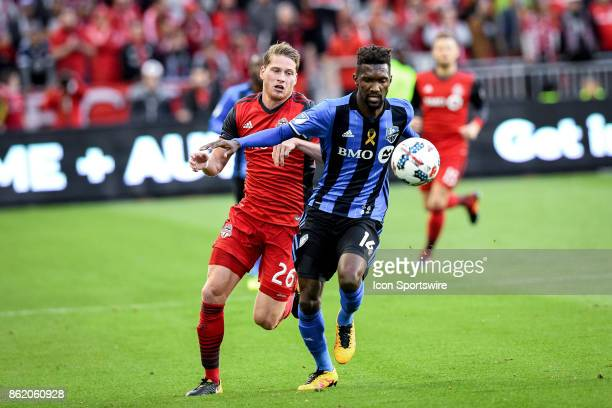 Nicolas Hasler of Toronto FC and Shaun Francis of Montreal Impact battle for the ball during the first half of the MLS Soccer regular season game...