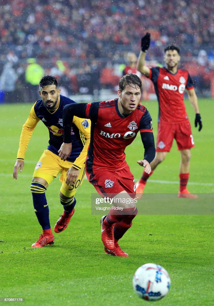 Nicolas Hasler #26 of Toronto FC Gonzalo Veron #30 of New York Red Bulls chase the ball during the second half of the MLS Eastern Conference Semifinal, Leg 2 game at BMO Field on November 5, 2017 in Toronto, Ontario, Canada.