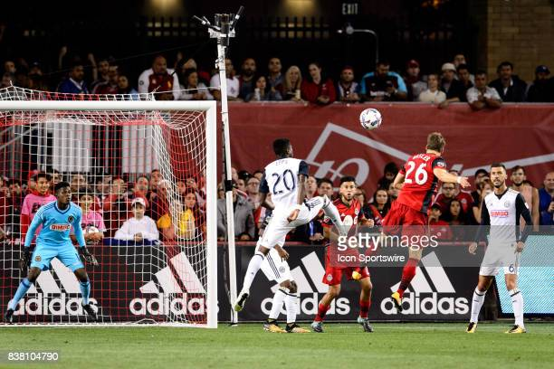 Nicolas Hasler of Toronto FC scores with a header during the first half of the MLS Soccer regular season game between Toronto FC and Philadelphia...