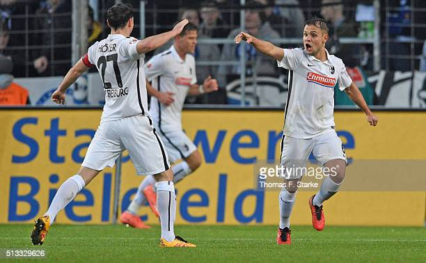 Nicolas Hoefler and Amir Abrashi of Freiburg celebrate during the Second Bundesliga match between Arminia Bielefeld and SC Freiburg at Schueco Arena...