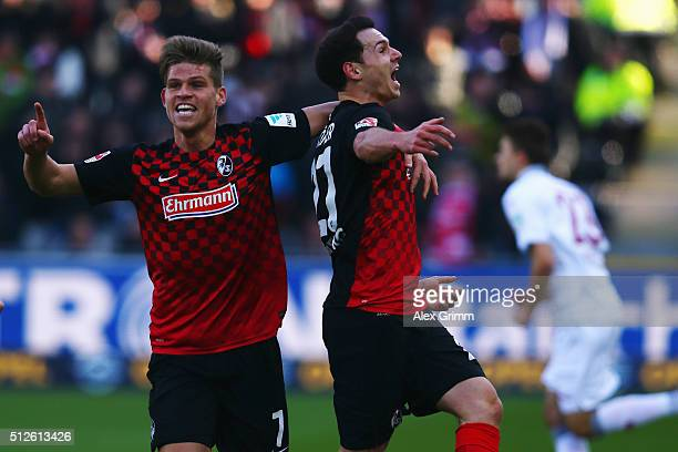 Nicolas Hoefler of Freiburg celebrates his team's first goal with team mate Florian Niederlechner during the Second Bundesliga match between SC...