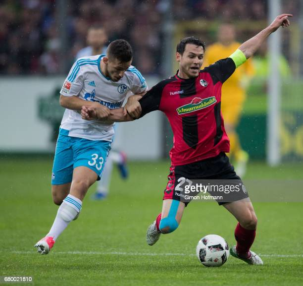 Nicolas Hoefler of Freiburg is challenged by Donis Avdijaj of Schalke during the Bundesliga match between SC Freiburg and FC Schalke 04 at...