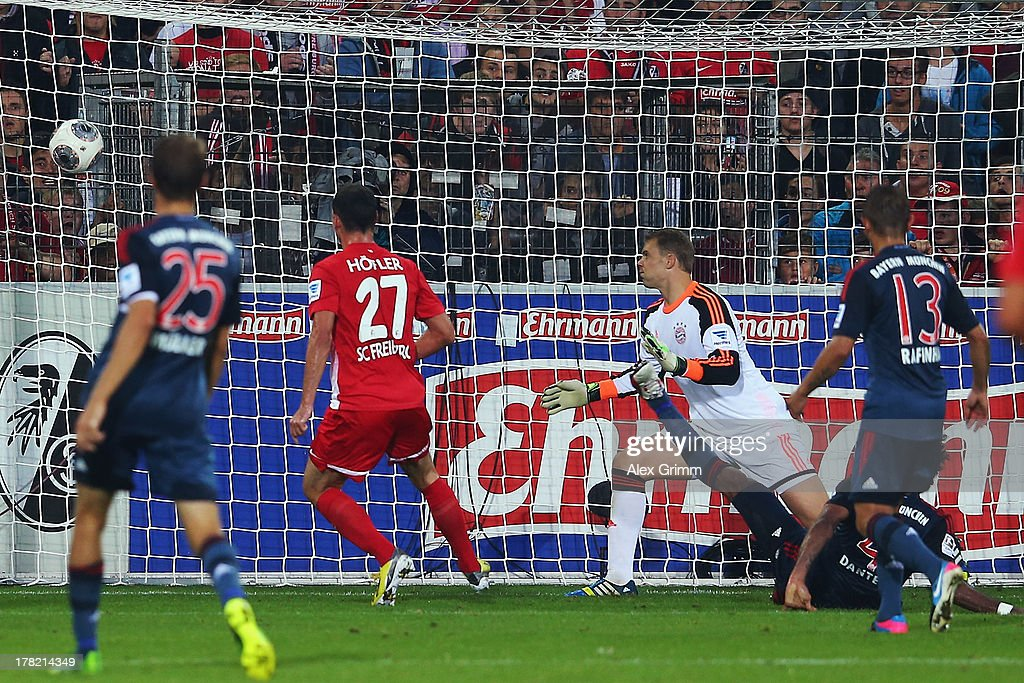 <a gi-track='captionPersonalityLinkClicked' href=/galleries/search?phrase=Nicolas+Hoefler&family=editorial&specificpeople=4645206 ng-click='$event.stopPropagation()'>Nicolas Hoefler</a> (2L) of Freiburg scores his team's first goal during the Bundesliga match between SC Freiburg and FC Bayern Muenchen at MAGE SOLAR Stadium on August 27, 2013 in Freiburg im Breisgau, Germany.
