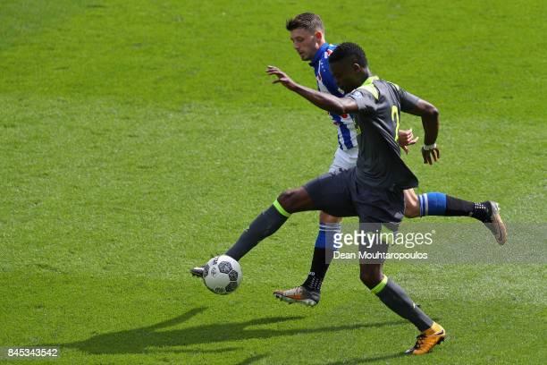 Nicolas IsimatMirin of PSV battles for the ball with Arber Zeneli of Heerenveen during the Dutch Eredivisie match between SC Heerenveen and PSV...