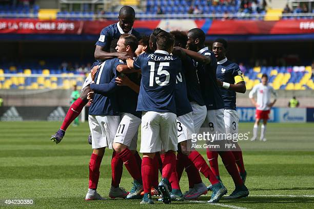 Nicolas Janvier of France celebrates his team's first goal with team mates during the FIFA U17 World Cup Chile 2015 Group F match between France and...