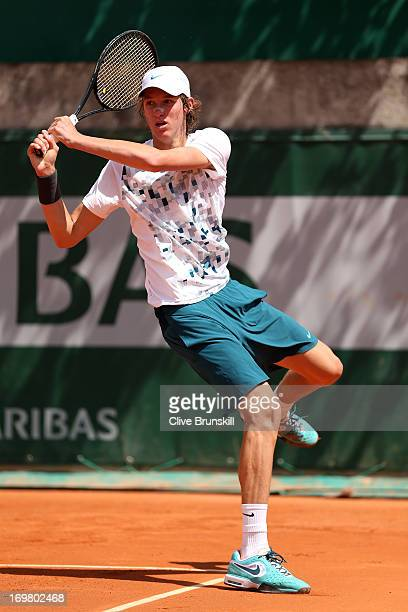 Nicolas Jarry of Chile plays a backhand during boys' singles match against Luca George Tatomir of Romania during day eight of the French Open at...