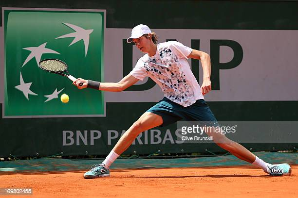 Nicolas Jarry of Chile plays a forhand during boys' singles match against Luca George Tatomir of Romania during day eight of the French Open at...
