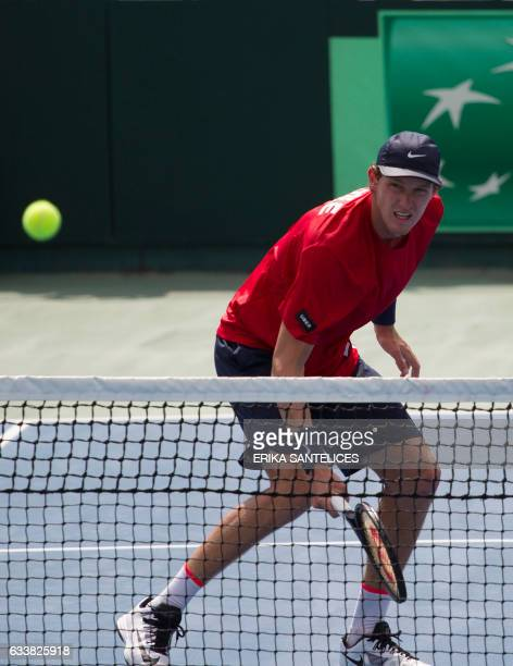 Nicolas Jarry of Chile returns the ball during the Davis Cup first round double tennis match against the Dominican Republic at Parque del Este in...