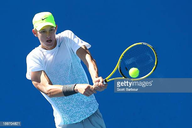 Nicolas Jarry of the United States plays a backhand in his first round match against Marc Polmans of Australia during the 2013 Australian Open Junior...