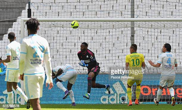 Nicolas Julio Nkoulou Ndoubena from Marseille score against his own team and goal keeper Steve Mandanda during the game between Olympique de...