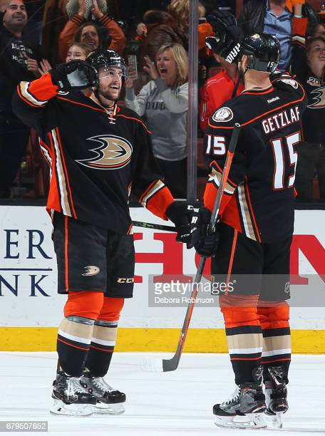 Nicolas Kerdiles and Ryan Getzlaf of the Anaheim Ducks celebrate their 43 win after double overtime against the Edmonton Oilers in Game Five of the...