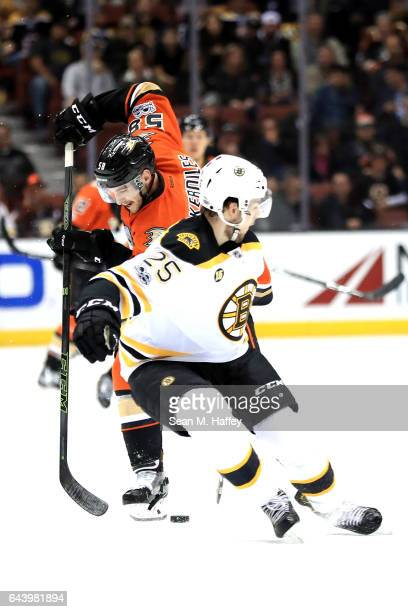 Nicolas Kerdiles of the Anaheim Ducks moves around Brandon Carlo of the Boston Bruins during the third period of a game at Honda Center on February...