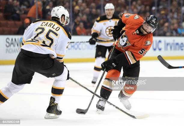 Nicolas Kerdiles of the Anaheim Ducks shoots the puck as Brandon Carlo of the Boston Bruins defends during the third period of a game at Honda Center...
