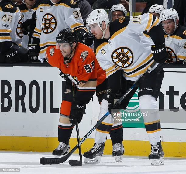 Nicolas Kerdiles of the Anaheim Ducks skates against Jimmy Hayes of the Boston Bruins during his NHL debut in the game on February 22 2017 at Honda...
