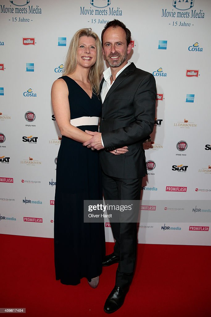 Nicolas Koenig (R) with his wife Inke poses during the event 'Movie Meets Media' at Hotel Atlantic on December 1, 2014 in Hamburg, Germany.