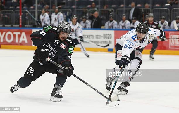 Nicolas Kraemmer of Koeln scores his teams second goal during the DEL match between Koelner Haie and Iserlohn Roosters at Lanxess Arena on October 9...