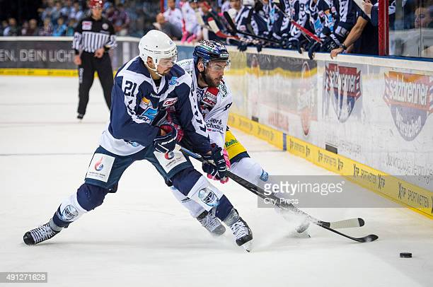 Nicolas Kraemmer of the Hamburg Freezers and Constantin Braun of the Eisbaeren Berlin during the game between Hamburg Freezers and Eisbaeren Berlin...