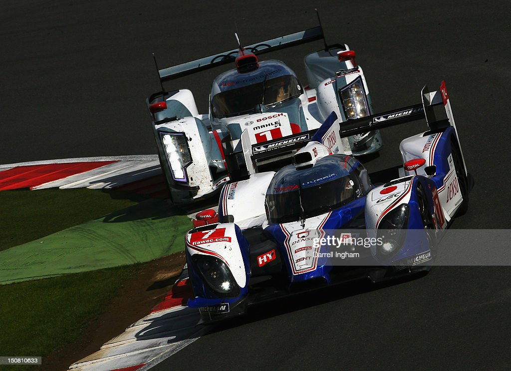 Nicolas Lapierre of France drives the #7 Toyota Racing Toyota TS030 Hybrid ahead of the #1 Audi Sport Team Joest Audi R18 e-tron Quattro driven by <a gi-track='captionPersonalityLinkClicked' href=/galleries/search?phrase=Andre+Lotterer&family=editorial&specificpeople=2380096 ng-click='$event.stopPropagation()'>Andre Lotterer</a> of Germany during the FIA World Endurance Championship 6 Hours of Silverstone race at the Silverstone Circuit on August 26, 2012 in Towcester, United Kingdom.
