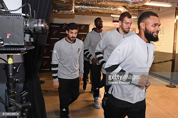 Nicolas Laprovittola and Patty Mills of the San Antonio Spurs run to the court before the game against the Sacramento Kings on October 27 2016 at the...