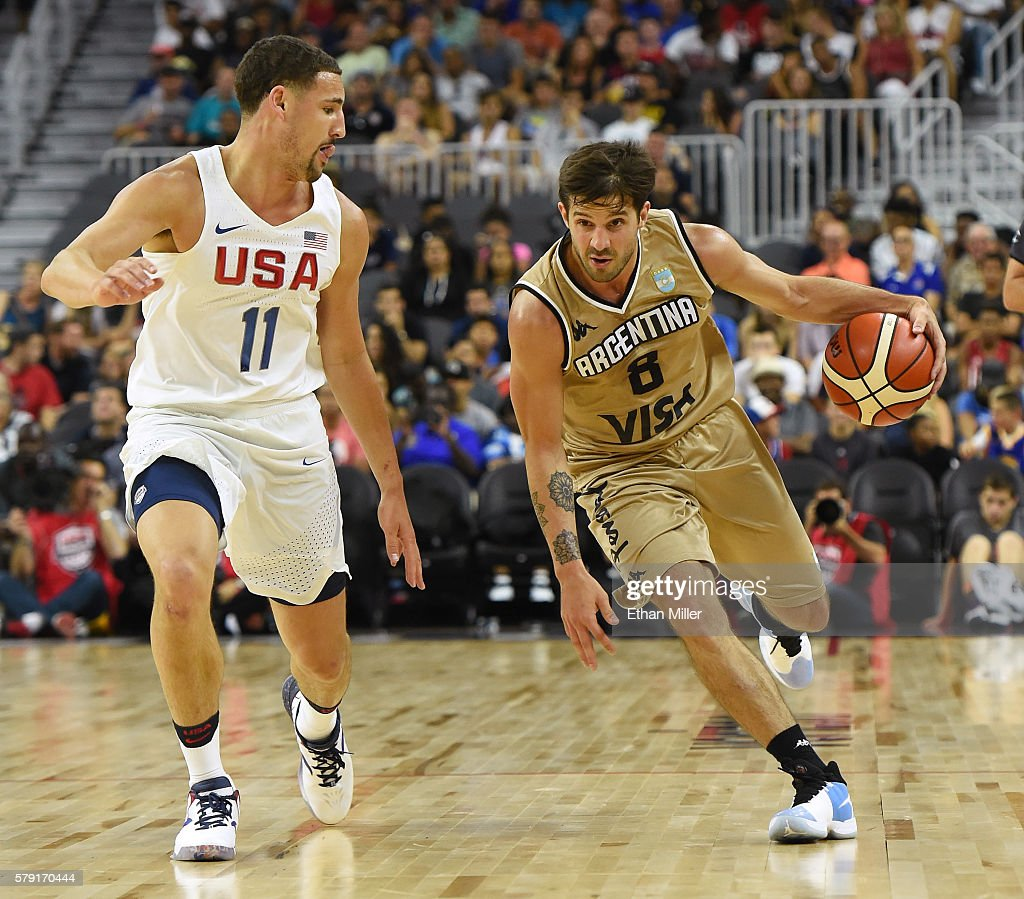 Nicolas Laprovittola of Argentina brings the ball up the court against Klay Thompson of the United States during a USA Basketball showcase exhibition...