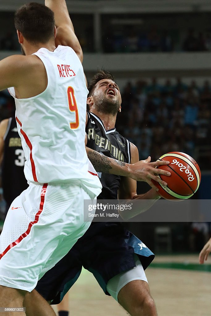 Nicolas Laprovittola of Argentina drives the ball against Felipe Reyes of Spain during a Men's Basketball Preliminary Round Group B game between...