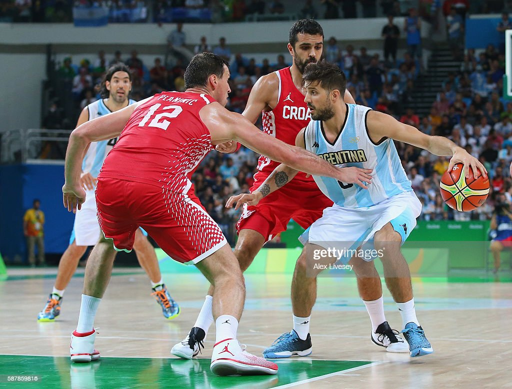 Nicolas Laprovittola of Argentina moves the ball against Darko Planinic of Croatia during a preliminary round basketball game between Croatia and...