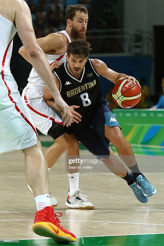 Nicolas Laprovittola of Argentina moves the ball against Sergio Rodriguez of Spain during a Men's Basketball Preliminary Round Group B game between...
